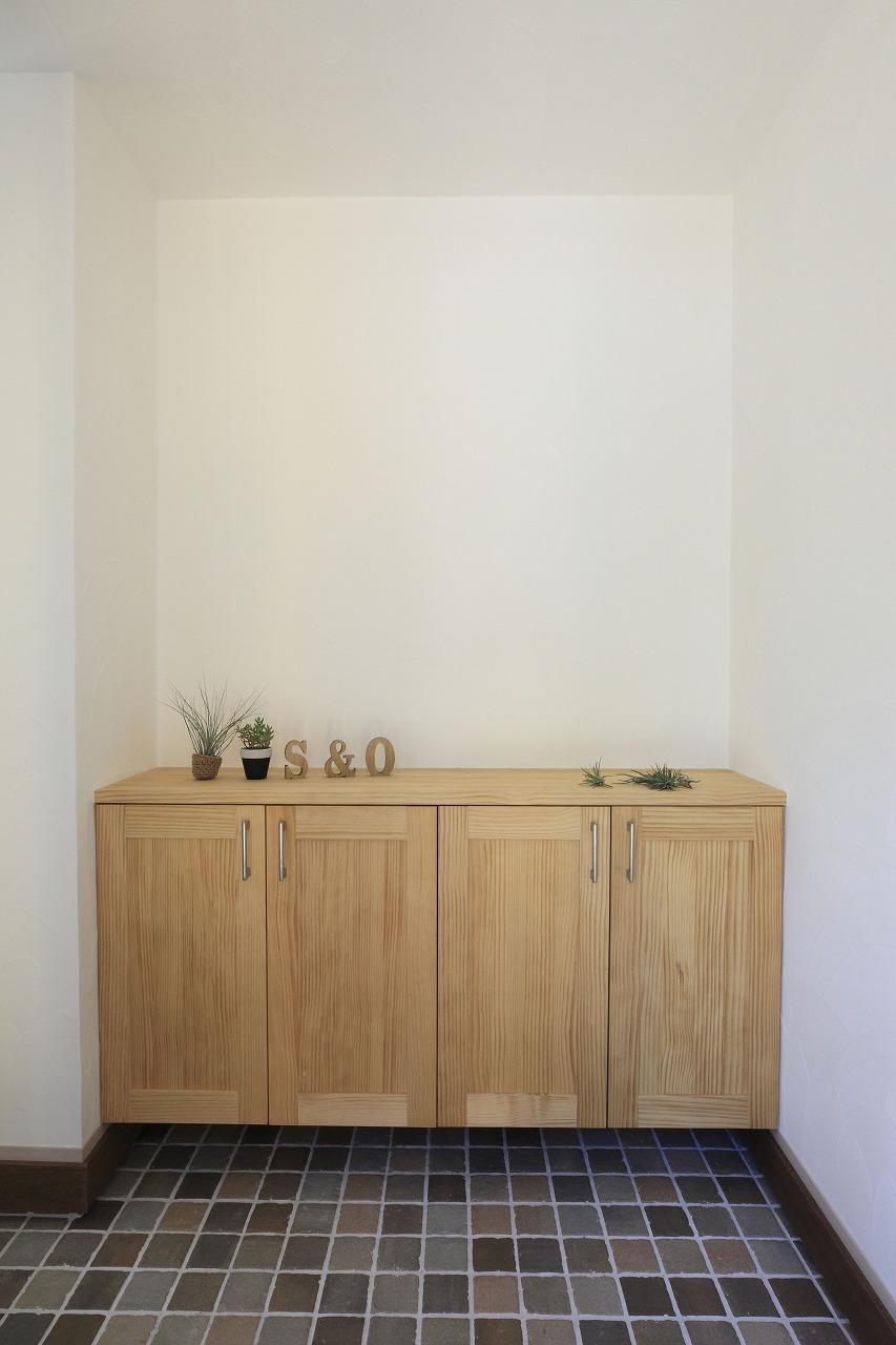 薪ストーブのあるL字型の平屋